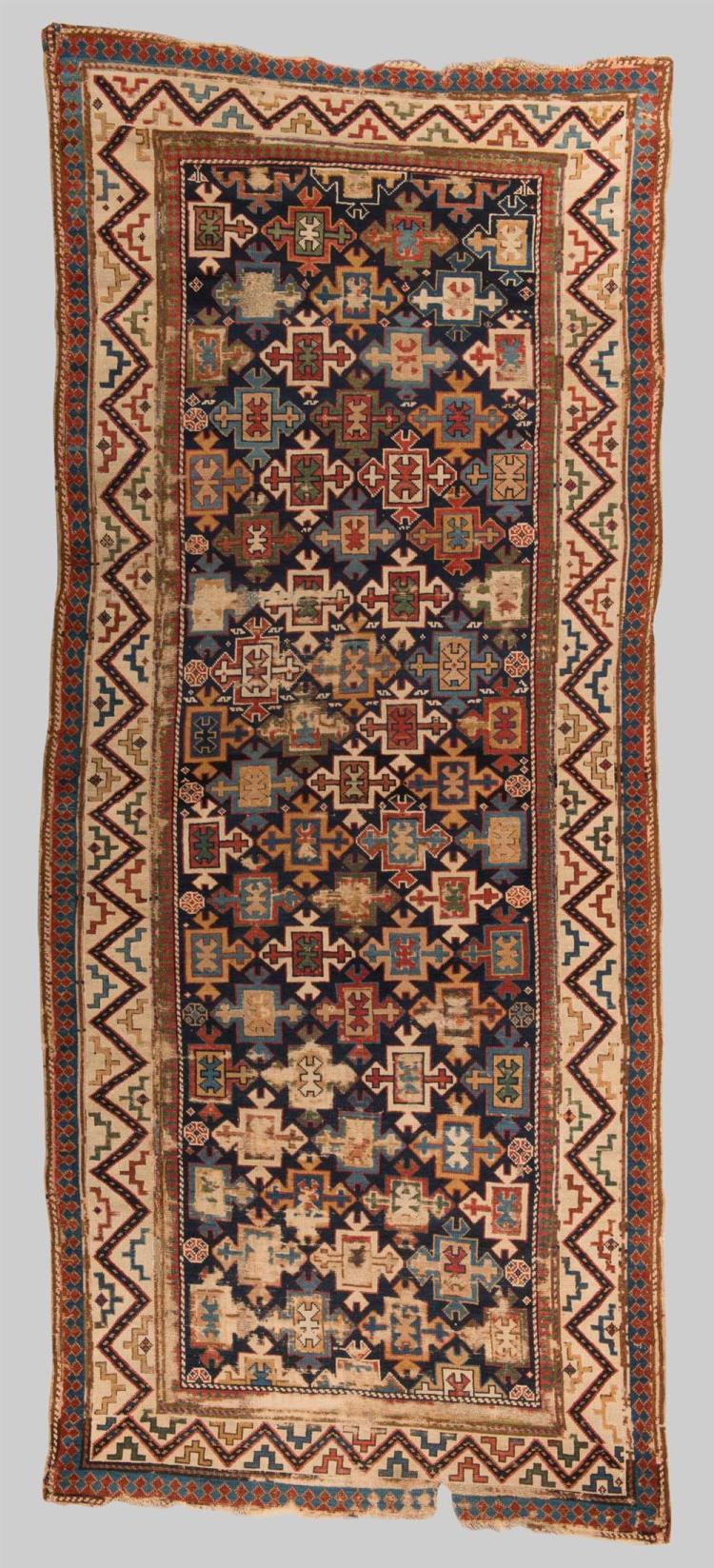 CAUCASIAN RUG, first half 19th century; 9 ft. 10 in. x 4 ft. 1 in.