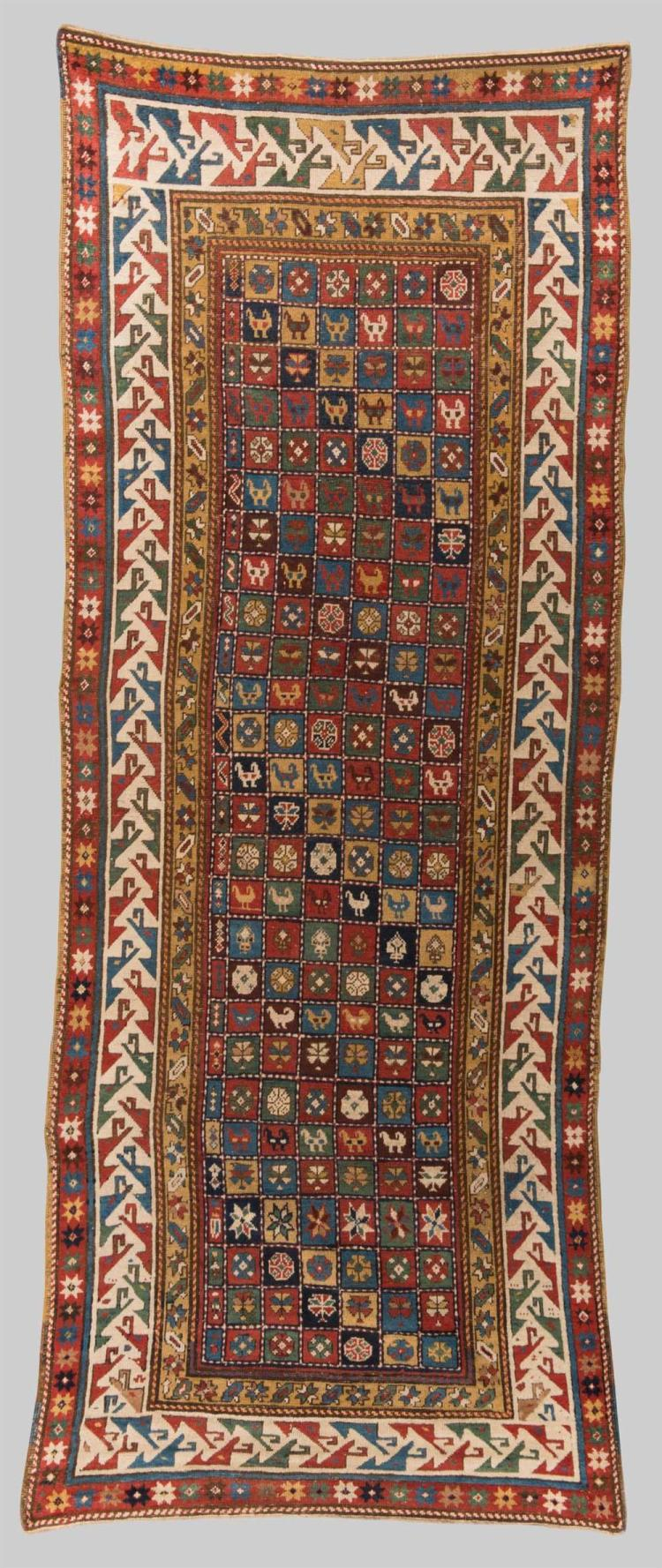 CAUCASIAN RUG, second half 19th century; 9 ft. 8 in. x 3 ft. 9 in.