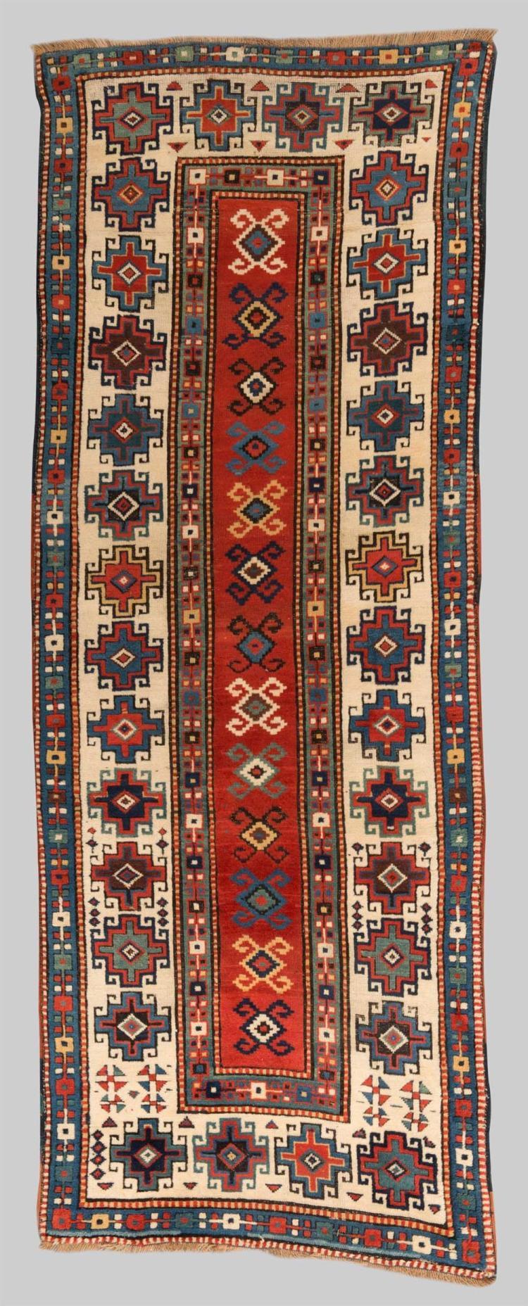 MOGHAN RUG, Caucasus, second half 19th century; 8 ft. 7 in. x 3 ft. 2 1/2 in.