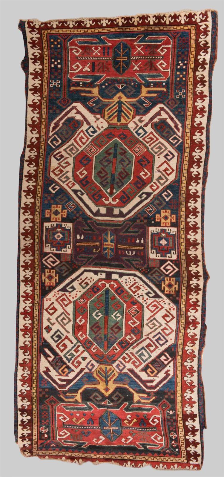 KARABAGH LENKORAN RUG, Caucasus, mid 19th century; 9 ft. 6 in . x 4 ft.