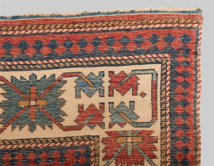 KAZAK RUG, Caucasus, mid 19th century; 3 ft. 10 in. x 3 ft. 4 in.