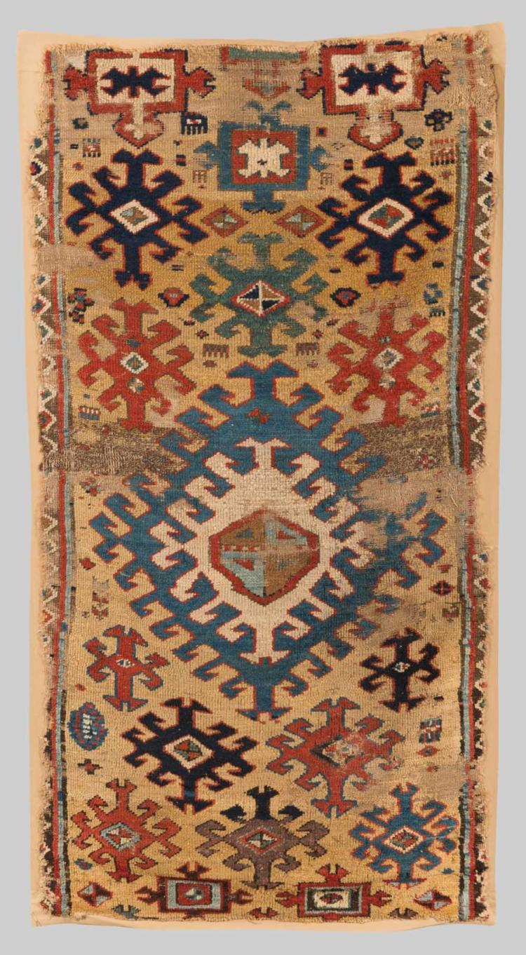 NORTHWEST PERSIAN RUG FRAGMENT, first half 19th century; 5 ft. 6 in. x 2 ft. 10 in.