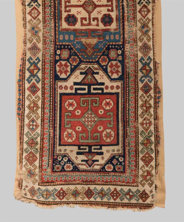 CAUCASIAN RUG, mid 19th century; 7 ft. 8 in. x 2 ft. 9 in.