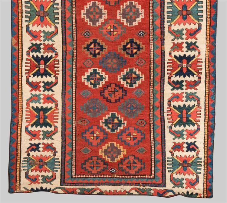 CAUCASIAN RUG FRAGMENT, Caucasus, first half 19th century; 6 ft. 3 in. x 3 ft. 6 in.