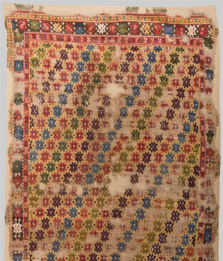 KONYA STAR CARPET, Anatolia, 18th/19th century; 13 ft. x 5 ft.