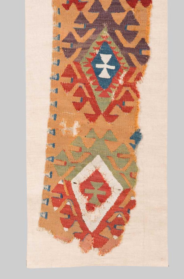 TURKISH KILIM FRAGMENT, 19th century; 3 ft. 9 in. x 8 1/2 in.