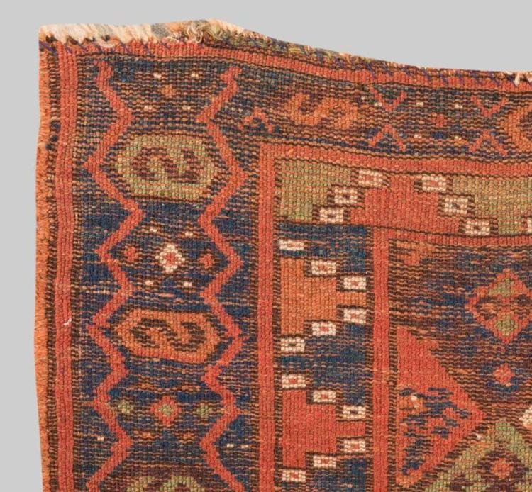 KURD JAFF BAG, Persia, ca. 1900; 2 ft. 8 in. x 1 ft. 10 in.; and KURDISH BORDER FRAGMENT, Persia, mid 19th century, 2 ft. 2 in. x 1 ft.