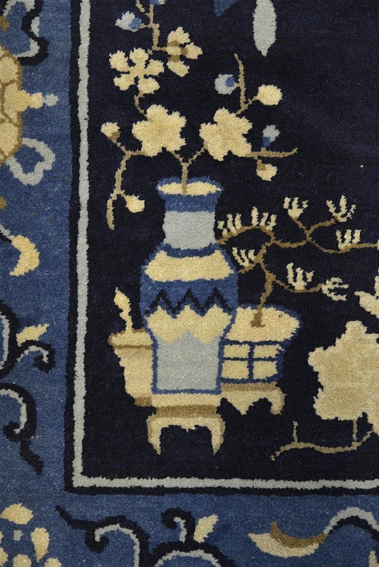 CHINESE RUG, ca. 1900;