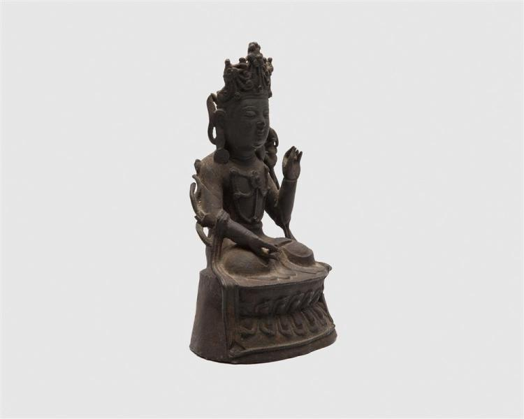 South East Asian Bronze Figure of a Seated Buddha, traces of gilding