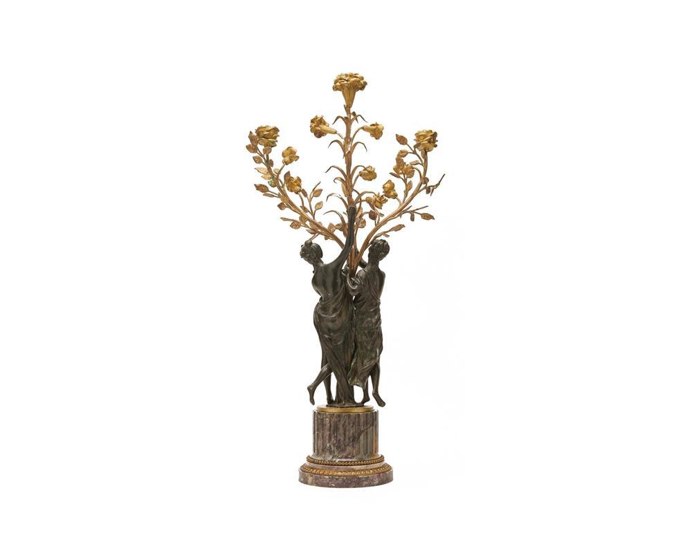 Continental Patinated and Gilt Bronze Figural Three Light Candelabra, ca. 1900, with lavender marble base