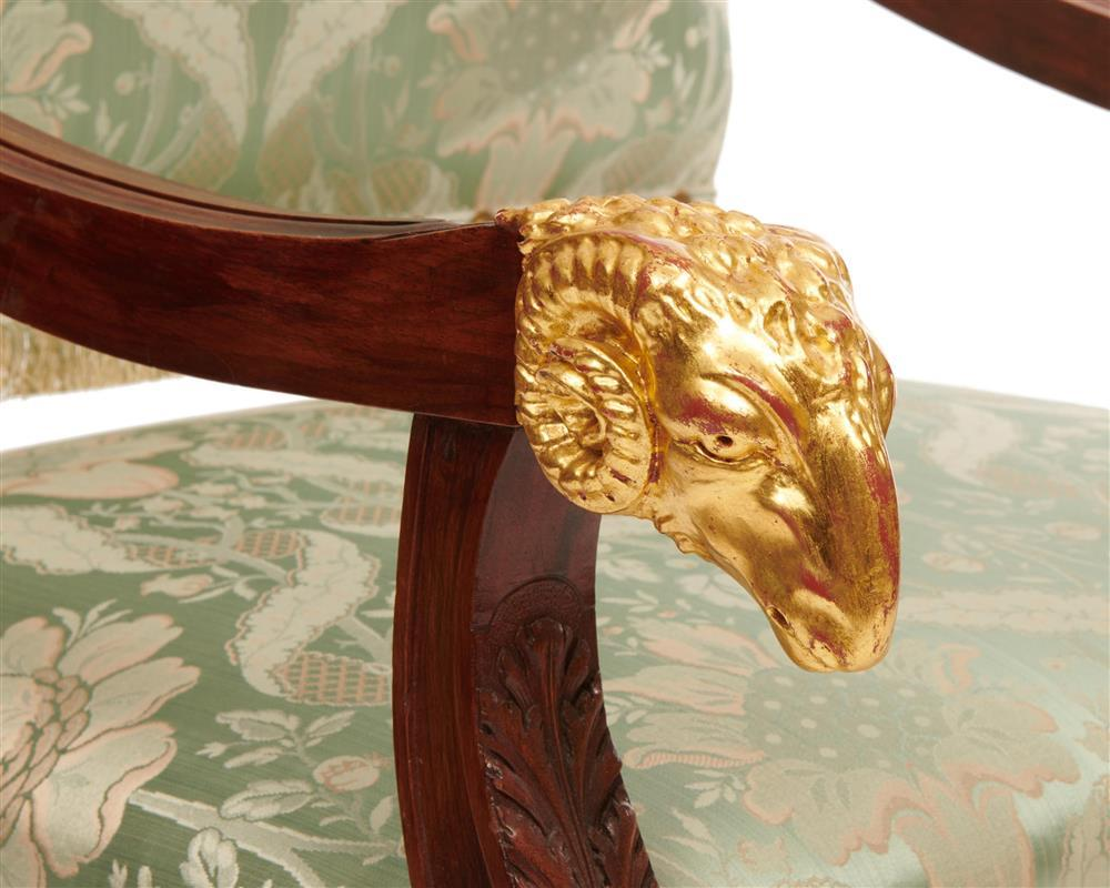 Pair of Continental Carved Mahogany and Parcel Gilt Fauteuil a la Reine, early 20th century, with rams head arms