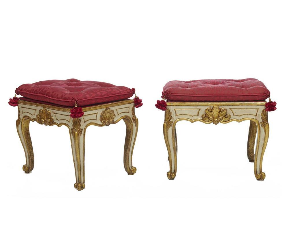 Pair of Continental Creme Painted Parcel Gilt Footstools, with red silk tasseled seats, 18th century