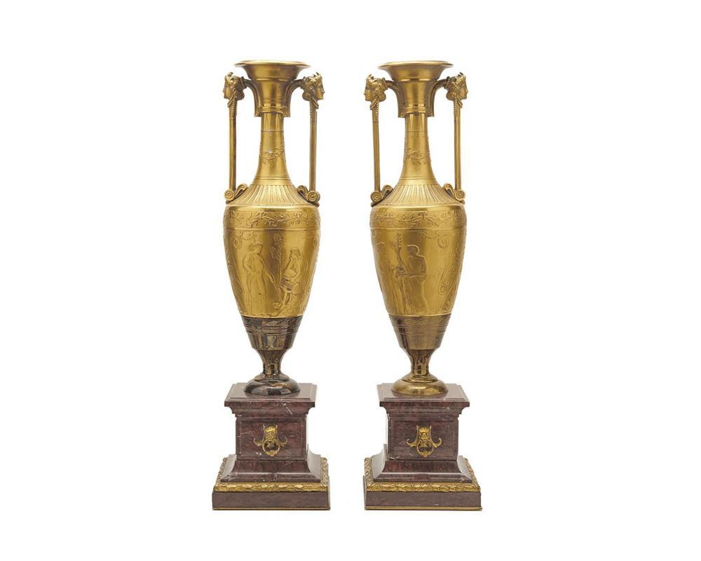 Pair of French Gilt Bronze and Rouge Marble Classical Urns, 19th century, with figural decoration; one inscribed Henry-Cahieux and F. Barbidenne Fondeur