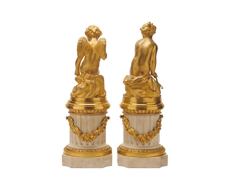 Pair of Louis XVI Style White Marble and Gilt Bronze Figures, late 19th century, one depicting a winged putto with quiver and the other depicting a young Diana, with bow
