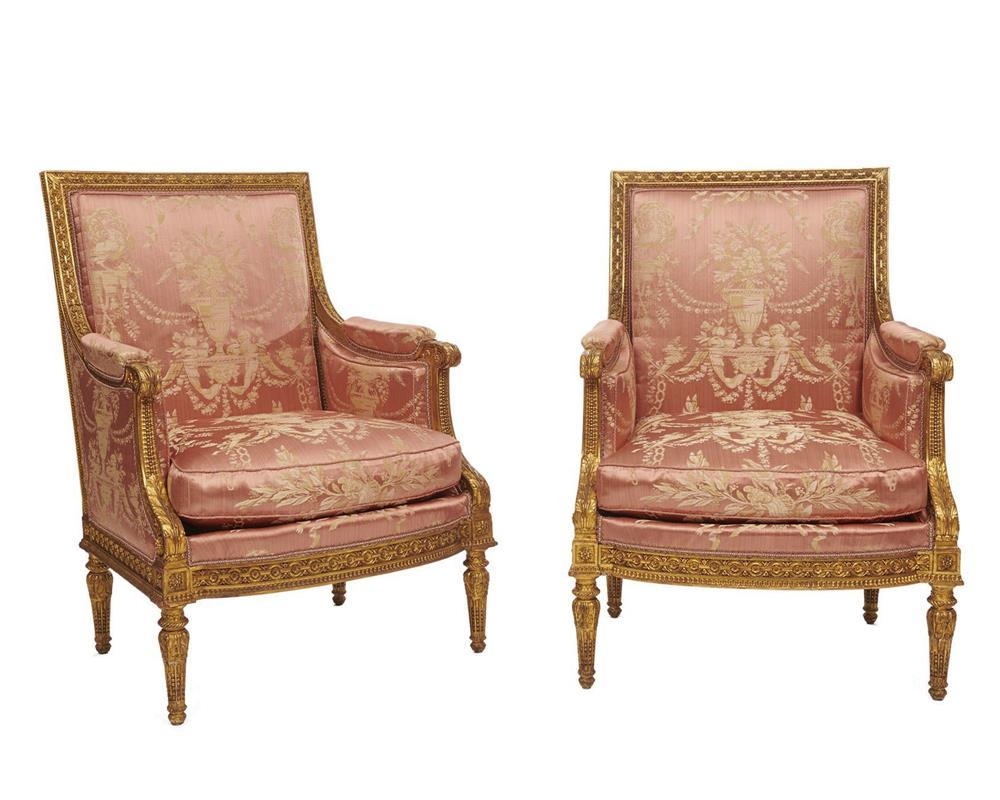 Pair of Louis XVI Style Carved and Gilt Painted Bergeres a la Reine, with rose silk upholstery, in the manner of Jean-Baptiste Sene