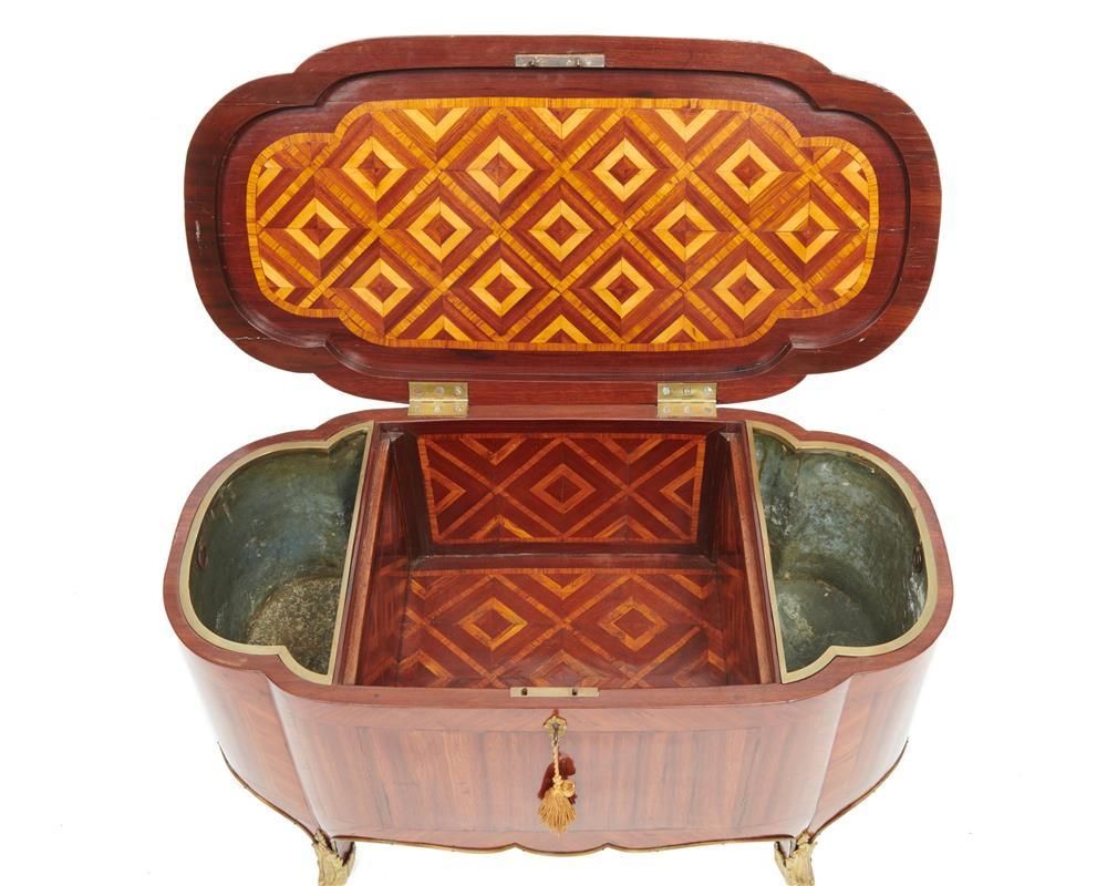 Louis XVI Style Ormolu Mounted Kingwood Footed Cellarette, 19th century, the parquetry inlaid interior fitted with metal liners