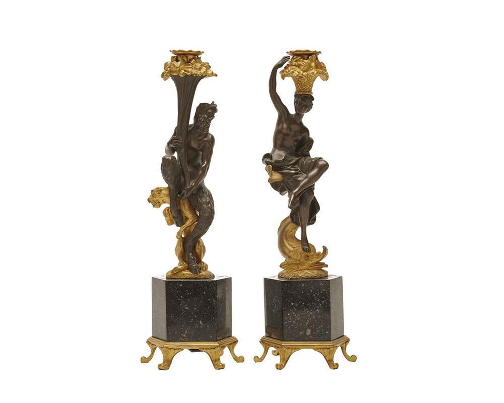 Pair of Continental Patinated and Gilt Bronze and Marble Figural Candlesticks, late 19th century, on footed octagonal bases