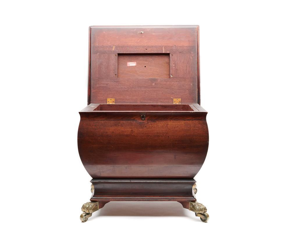 Regency Mahogany Cellarette, with brass paw feet and casters and loose ring lion head handles, 19th century