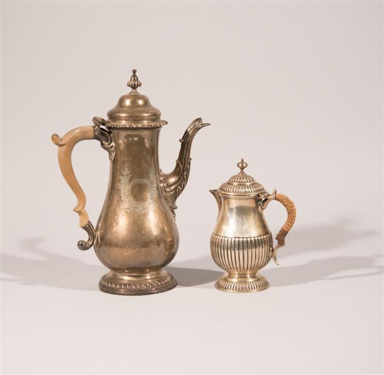 GEORGIAN SILVER COFFEE POT, London, 1765, William Plummer, maker together with A LATE GEORGIAN SILVER HOT WATER JUG, London, 1810, G...