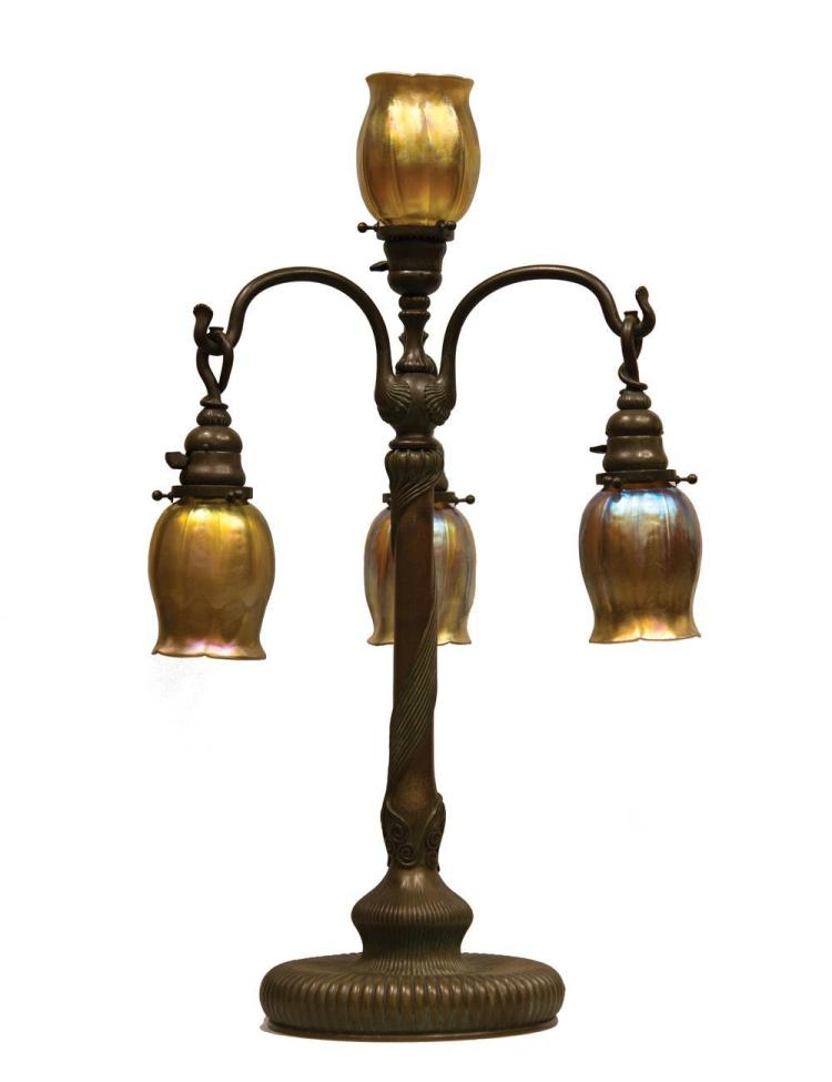 TIFFANY STUDIOS FAVRILLE GLASS AND BRONZE FOUR LIGHT NEWEL POST TABLE LAMP
