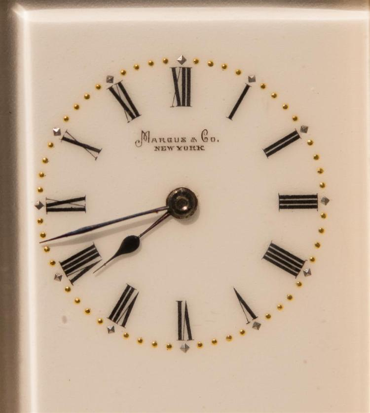 MINIATURE TRAVEL BRASS AND BEVELED GLASS CARRIAGE CLOCK, Marcus & Co., New York, retailer