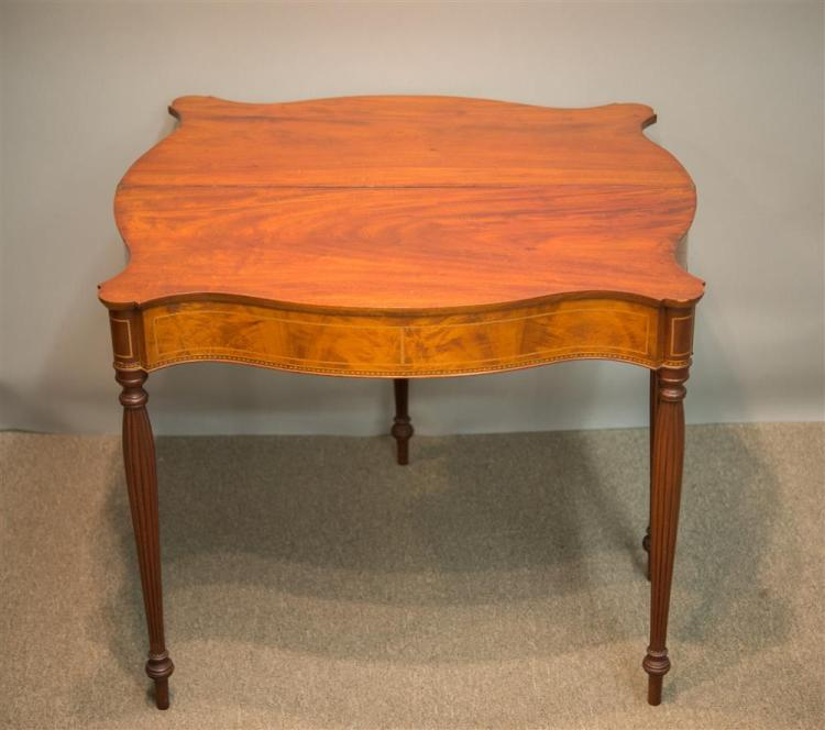 FEDERAL MAHOGANY INLAID SERPENTINE FRONT LIFT TOP SWING LEG GAMES TABLE, early 19th century