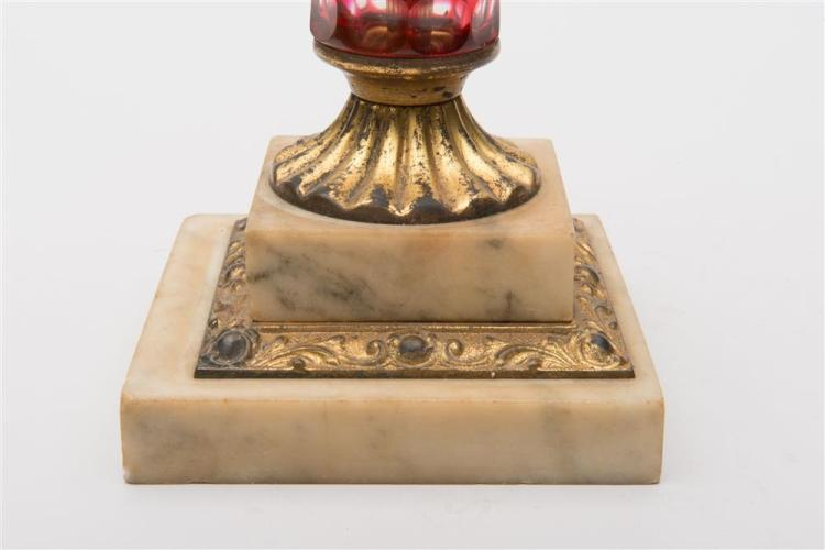 CRANBERRY CUT GLASS OIL LAMP, 19th century, with gilt metal mounts and marble base