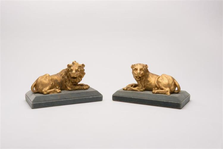 PAIR OF CONTINENTAL GILT BRONZE FIGURES, depicting a recumbent lion and lioness, 19th century