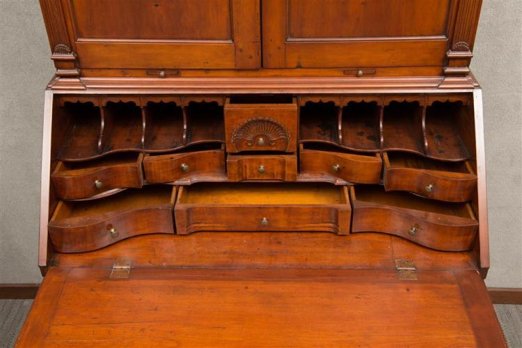 RARE CHIPPENDALE CARVED CHERRYWOOD DESK AND BOOKCASE, attributed to Calvin Willey, probably Lenox, Massachusetts, ca. 1790