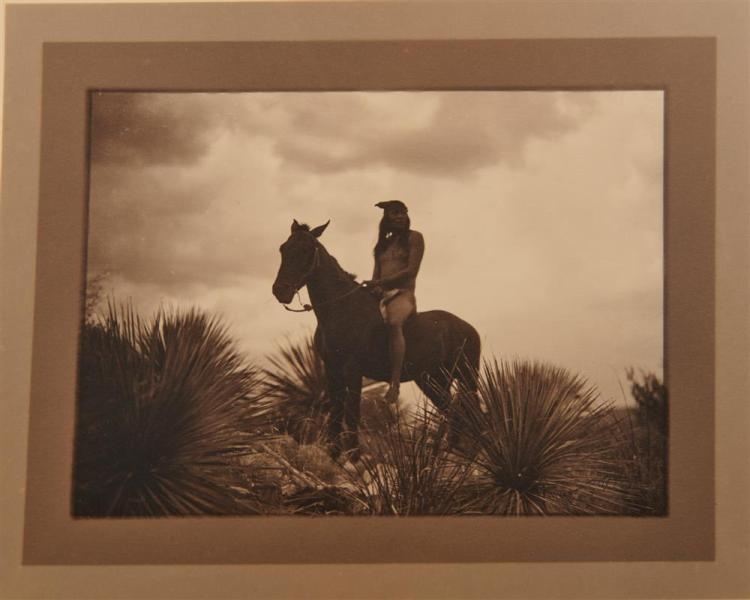 EDWARD SHERIFF CURTIS, (American, 1868-1952), The Scout - Apache, double border silver gelatin print, image: 5 3/4 x 7 3/4 in., frame: 10 1/4 x 12 5/8 in.