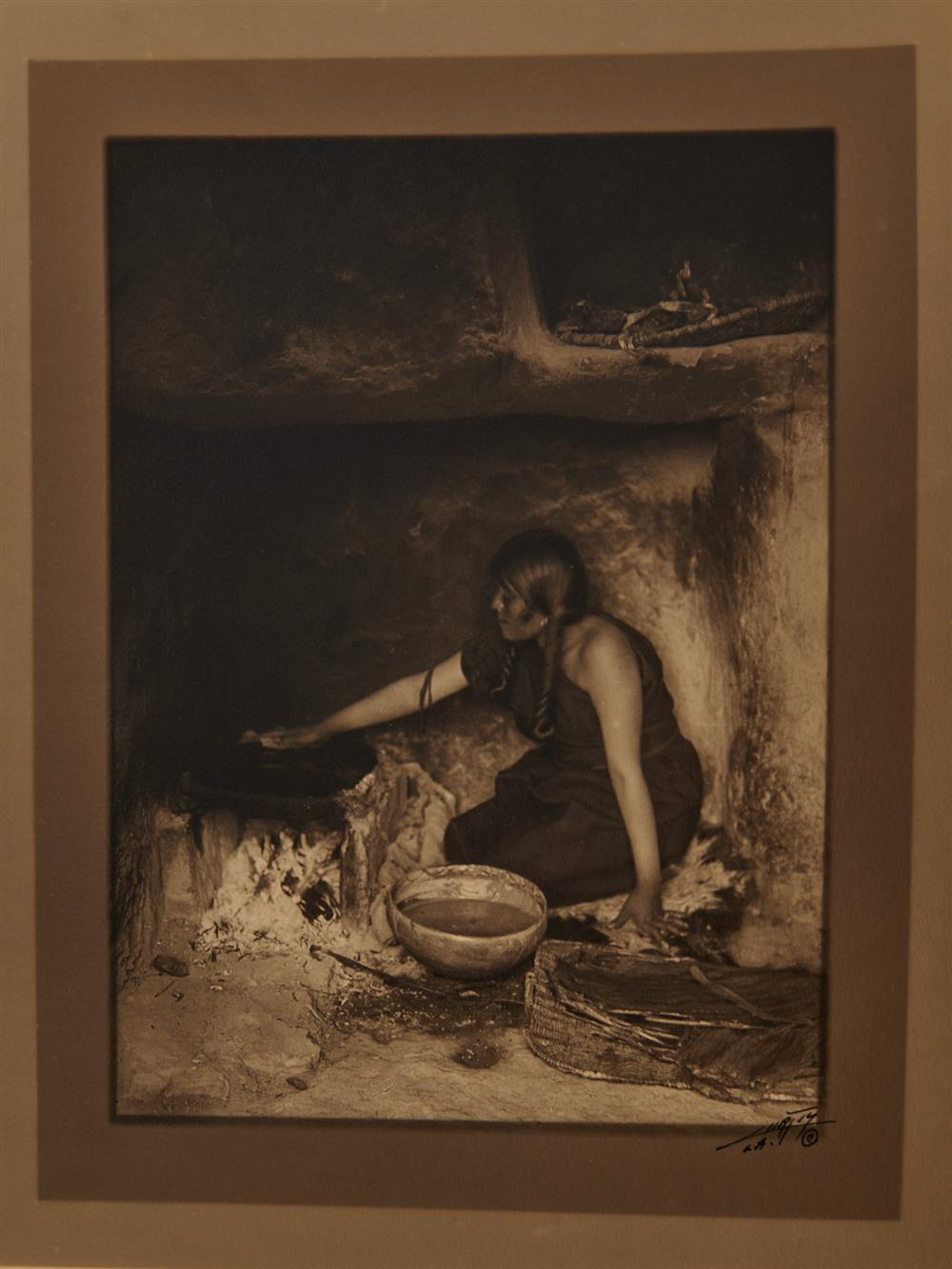 EDWARD SHERIFF CURTIS, (American, 1868-1952), The Piki Maker, double border silver gelatin print, image: 7 1/2 x 5 5/8 in.; sheet: 13 3/8 x 10 in.