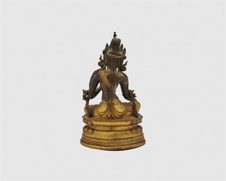Gilt and Patinated Copper Figure of a Seated Deity