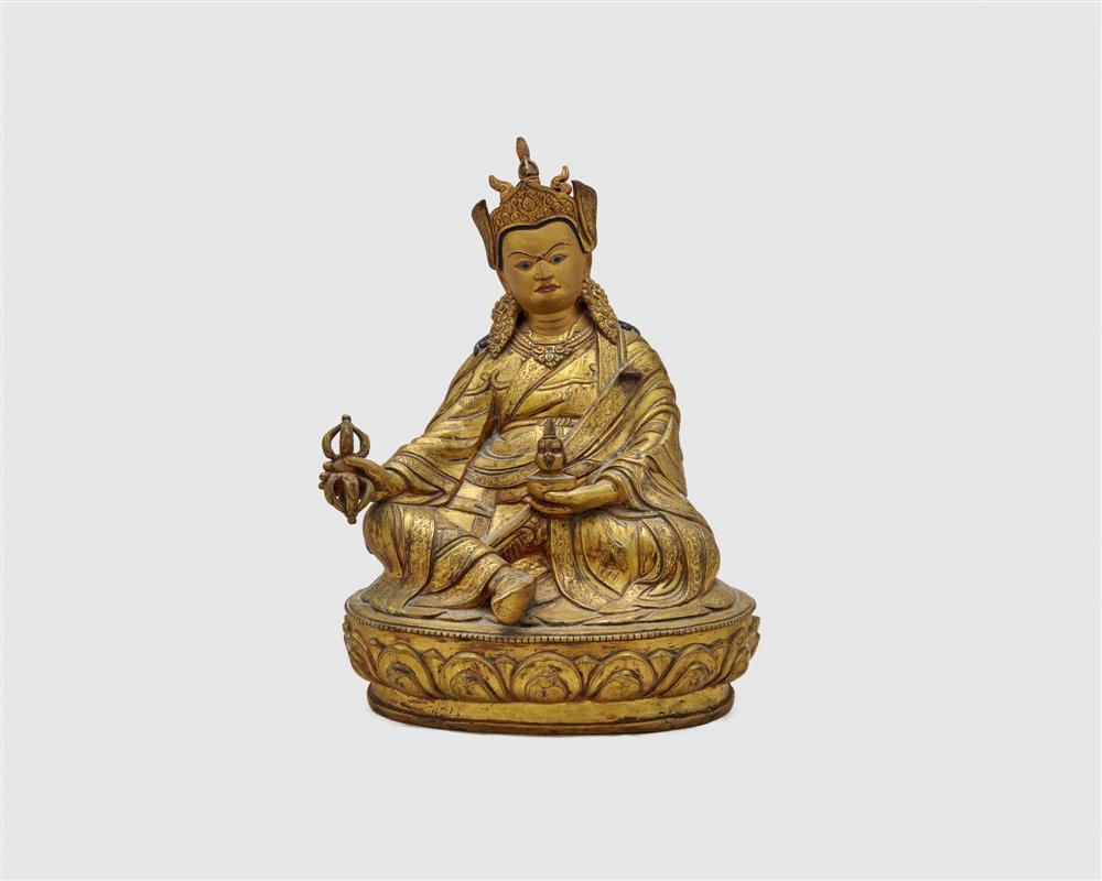 Gilt and Painted Bronze Figure of a Seated Deity