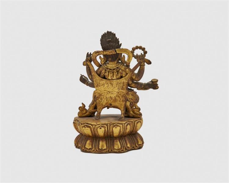 Gilt and Patinated Bronze Figure of a Standing Six Armed Deity with an Elephant Pelt, possibly Mahakala