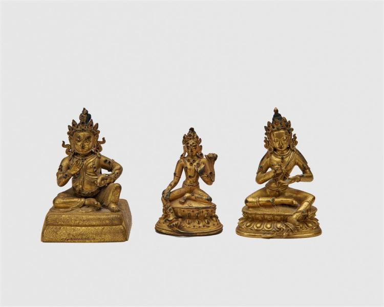 Three Gilt Bronze Figures of Seated Deities