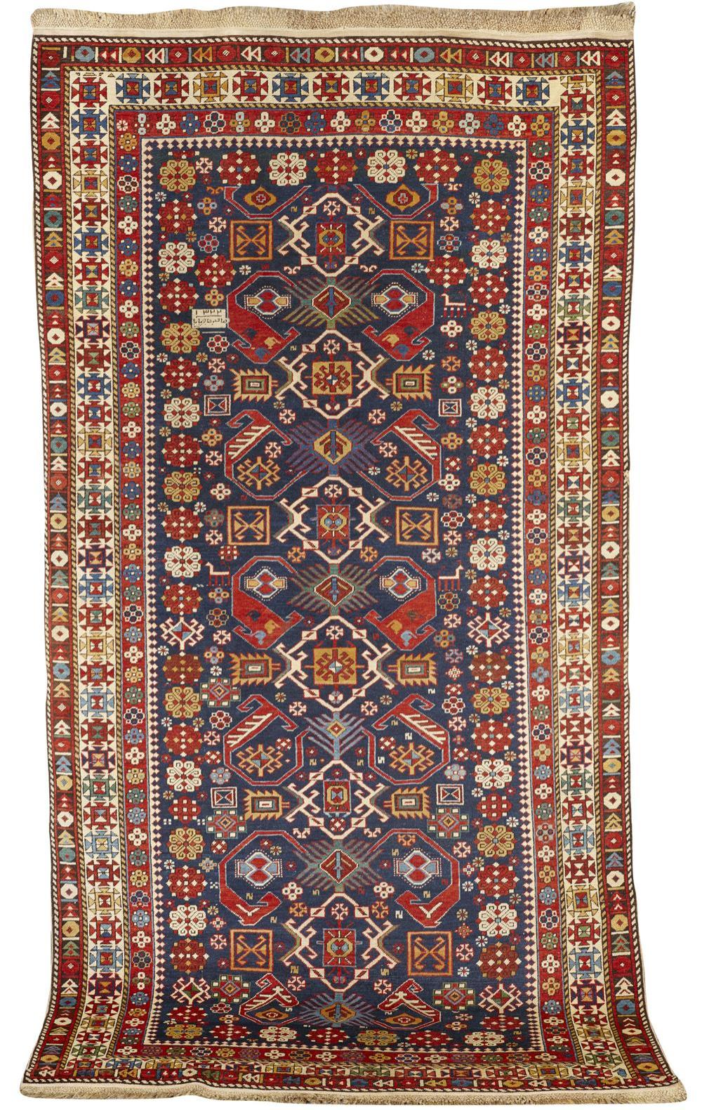 Shirvan Rug, Caucasus, dated 1322 (1905) and inscribed; 9 ft. x 4 ft. 8 in.