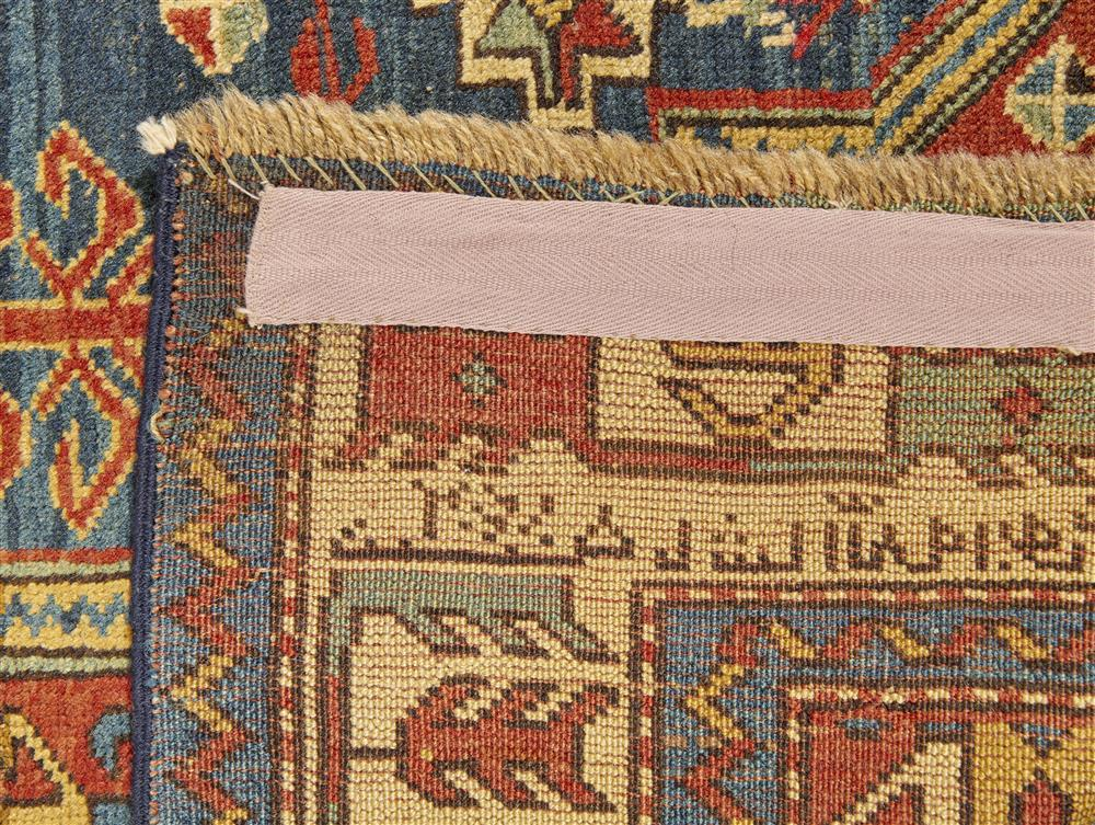 Fachralo Kazak Prayer Rug, Caucasus, ca. 1900, with inscription panel; 5 ft. 6 in. x 3 ft. 11 in.