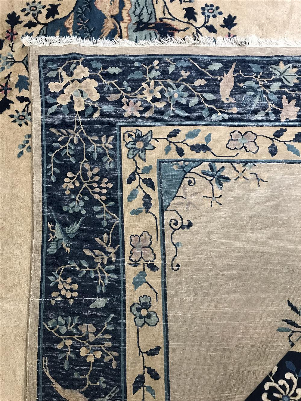 Chinese Peking Carpet, ca. 1900, altered in length at both ends; 10 ft. 7 in. x 11 ft. 7 in.