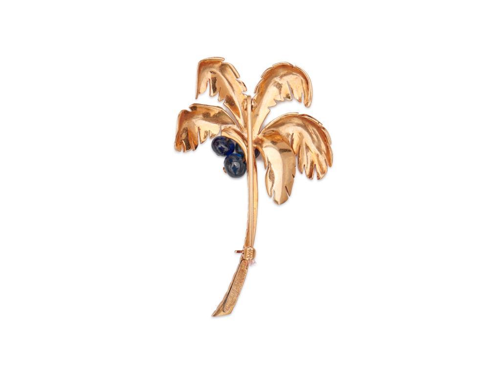 TRABERT & HOEFFER MAUBOUSSIN 14K Gold and Sapphire Palm Tree Brooch