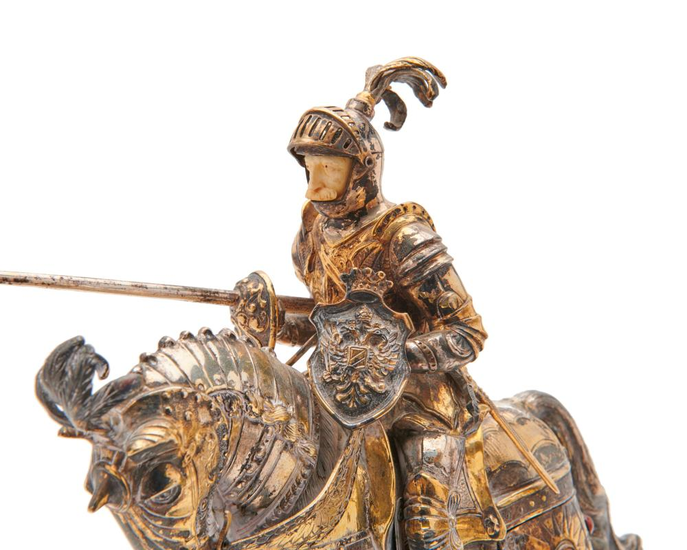 Two Similar German Silver and Gilt Silver Jousting Knights, early 20th century
