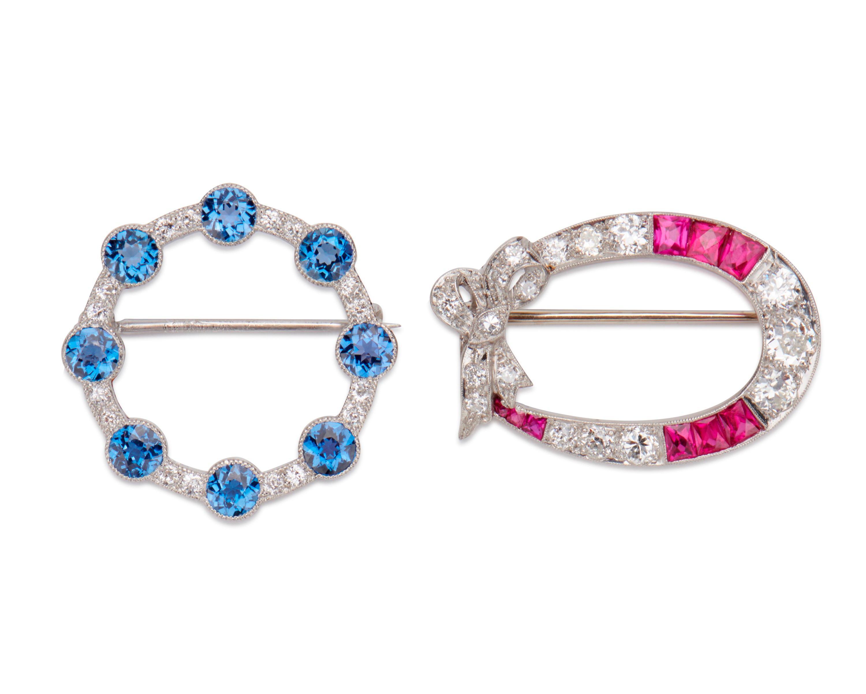 Two Platinum, Diamond, and Gemset Brooches