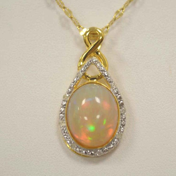 Sterling silver opal and diamond pendant for Gulf coast coin and jewelry