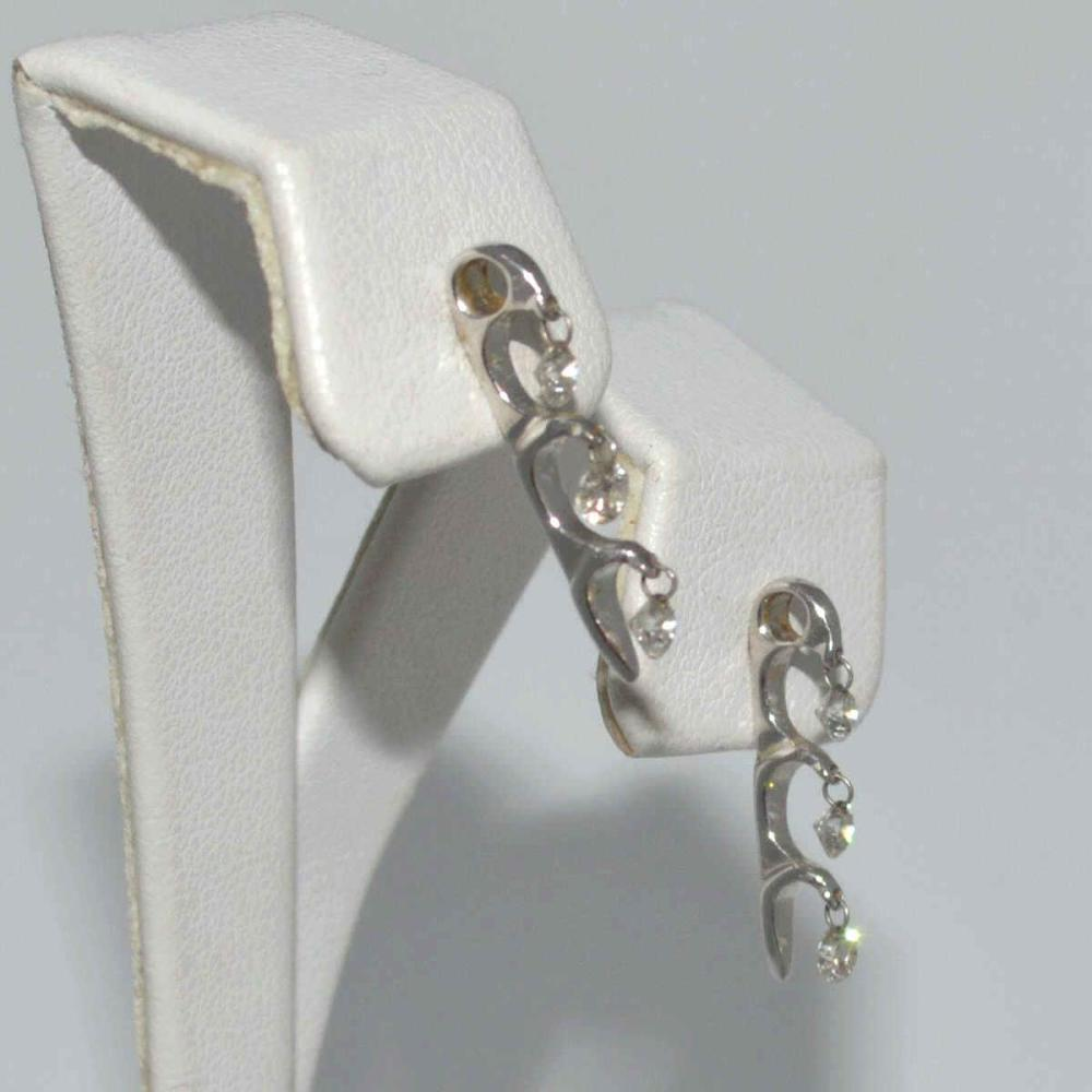 14kt white gold dancing diamond earrings