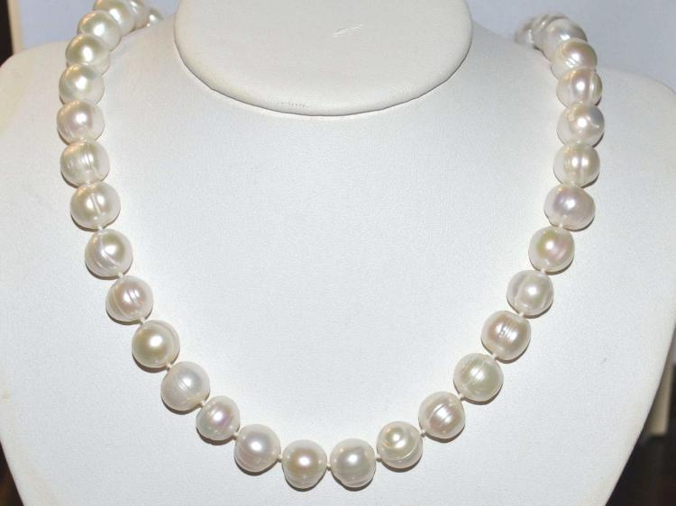 Strand of baroque pearls for Gulf coast coin and jewelry