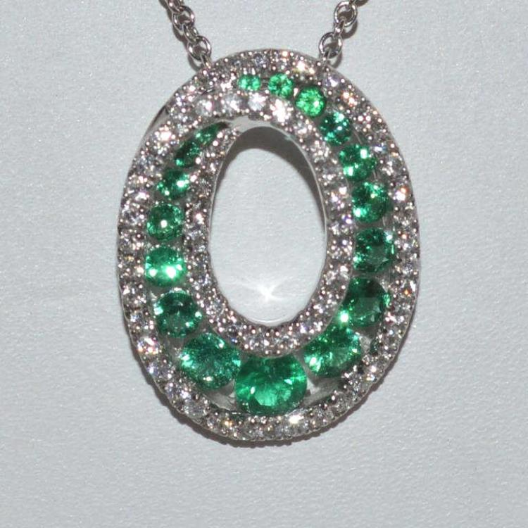 14kt white gold emerald and diamond pendant for Gulf coast coin and jewelry