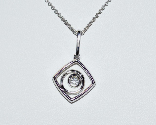 14kt spiral diamond pendant for Gulf coast coin and jewelry