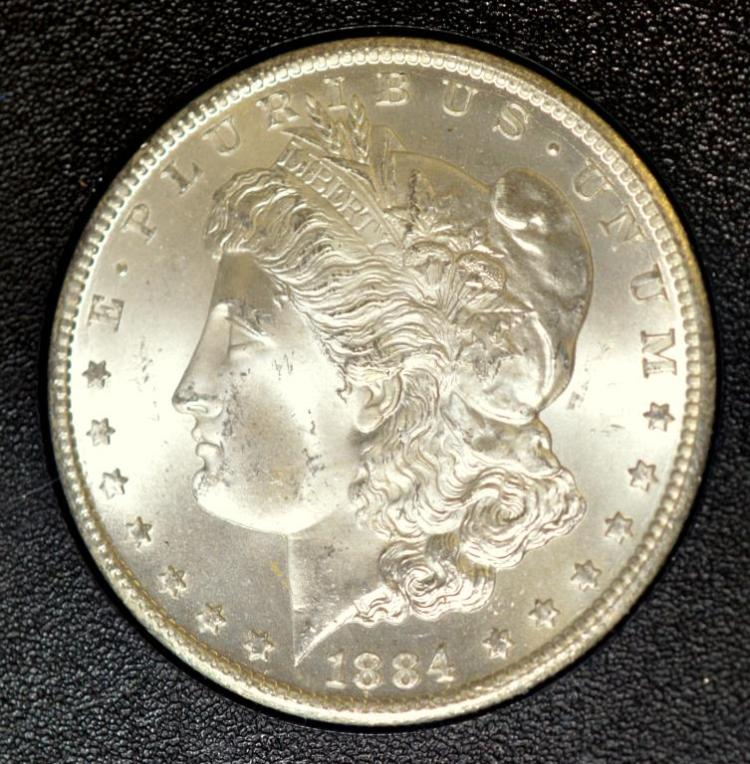 1884-CC Morgan Silver Dollar GSA Hoard NGC MS 65
