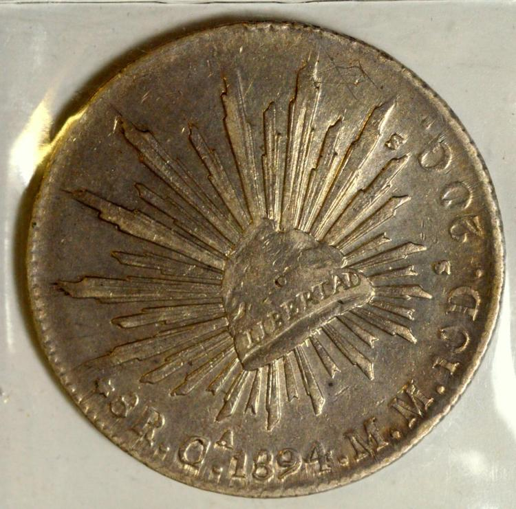 1894Ca MM Mexico Silver 8 Reales VF, Chopmark