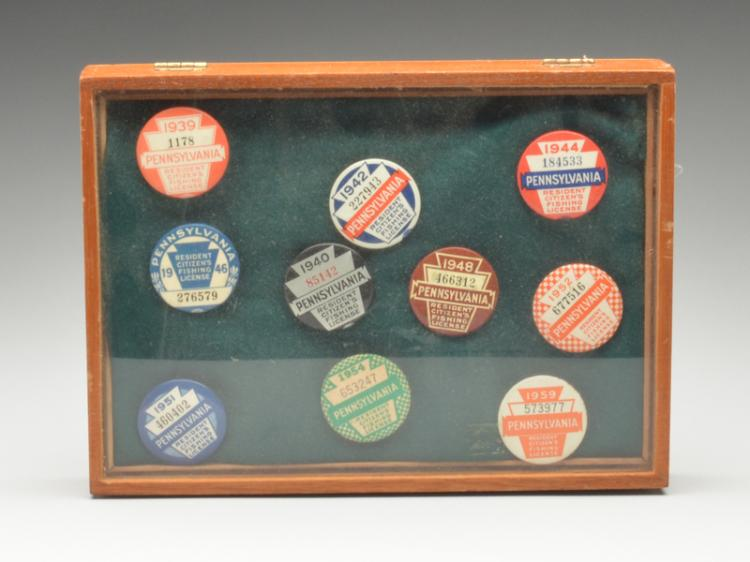 Ten State of Pennsylvania resident hunting license pins.