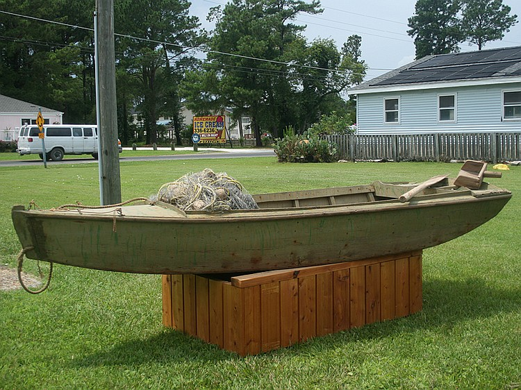 Cigar Daisy's gunning boat with oar and water scoop, circa 1960.
